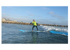 How to stand up on surfboard